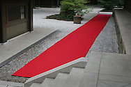 A red carpet lays drying in the courtyard of Meiji Jingu shinto shrine in Harajuku district of Tokyo, Japan.