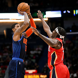 Feb 14, 2019; New Orleans, LA, USA; Oklahoma City Thunder forward Paul George (13) shoots over New Orleans Pelicans guard Jrue Holiday (11) during the second quarter at the Smoothie King Center. Mandatory Credit: Derick E. Hingle-USA TODAY Sports