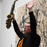 John Zorn acknowledges the crowd in the Met's Modern and Contemporary galleries after a performance.