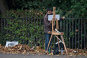 A member of the Dulwich Art Group paints an urban Autumn landscape on Denmark Hill, on 2nd October 2017, in the south London borough of Lambeth, England.