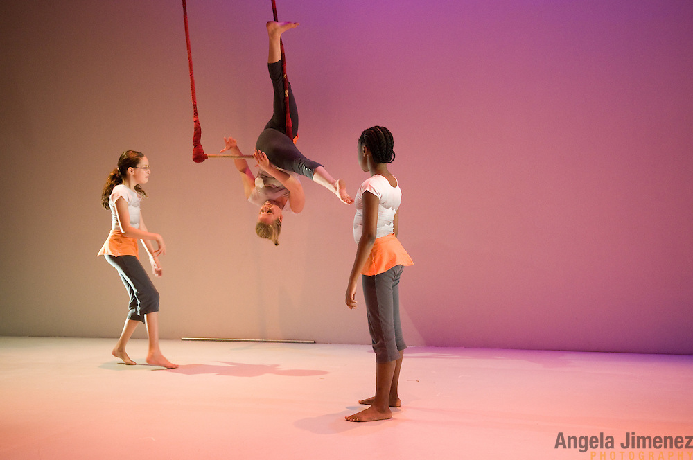 The LAVA acrobatics company performs Atlas at Dixon Place in New York City on December 3, 2011. Also performing is the MAGMA junior company. ..Photo by Angela Jimenez for LAVA.www.angelajimenezphotography.com