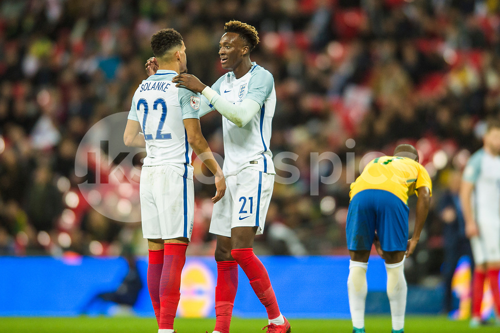 Tammy Abraham of England consoles team mate Dominic Solanke after his effort was saved during the international friendly match between England and Brazil at Wembley Stadium, London, England on 14 November 2017. Photo by Darren Musgrove.