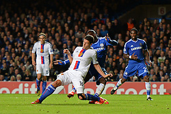 LONDON, ENGLAND - September 18: Basel's Fabian Schar is fouled by Chelsea's Samuel Eto'o  during the UEFA Champions League Group E match between Chelsea from England and Basel from Switzerland played at Stamford Bridge, on September 18, 2013 in London, England. (Photo by Mitchell Gunn/ESPA)