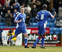 Photo: Chris Ratcliffe.<br />Gillingham v Bristol City. Coca Cola League 1. 26/12/2005.<br />Michael Flynn (L) of Gillingham celebrates his equaliser with Ian Cox.