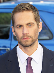© London News Pictures. US actor Paul Walker, who starred in the Fast & Furious series of action films, has been killed in a car crash in California on 30 November 2013. Seen here at the The Fast And The Furious 6 World Film Premiere; Empire Cinema Leicester Square; London UK; 08 May 2013; Photo by Richard Goldschmidt/LNP