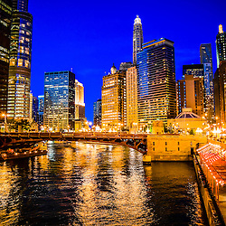 Chicago River and buildings at night picture high resoluion. Photo includes State Street bridge and other downtown Chicago office buildings.