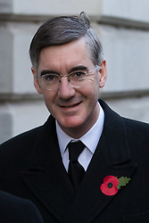 © Licensed to London News Pictures. 10/11/2019. London, UK. Leader of the House of Commons, Jacob Rees-Mogg walks through Downing Street to attend the Remembrance Sunday Ceremony at the Cenotaph in Whitehall. Remembrance Sunday events are held across the country today as the UK remembers and honours those who have sacrificed themselves in two world wars and other conflicts. Photo credit: Vickie Flores/LNP