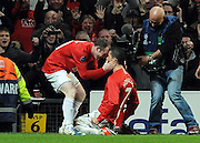 Cristiano Ronaldo celebrates scoring the second goal with Wayne Rooney during the UEFA Champions League First Knockout Round Second Leg match between Manchester United and Inter Milan at Old Trafford on March 11 2009, in Manchester, England.