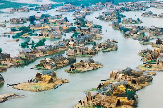 Aerial view of Marsh Arab reed house village in the Marshes of Southern Iraq where the Euphrates and Tigris Rivers meet