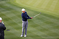 Tiger Woods chips to the green<br /> WM Phoenix Open 2015, TPC Scottsdale, Arizona, USA<br /> January 2015<br /> Picture Credit:  Mark Newcombe / www.visionsingolf.com