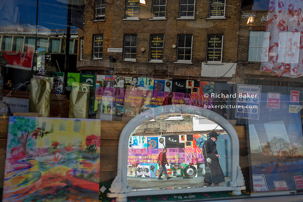 Mirrored construction and regeneration hoardings featuring local arts and community on 7th March 2017, on Station Square, Railton Road in Herne Hill, SE24, London borough of Lambeth, England.