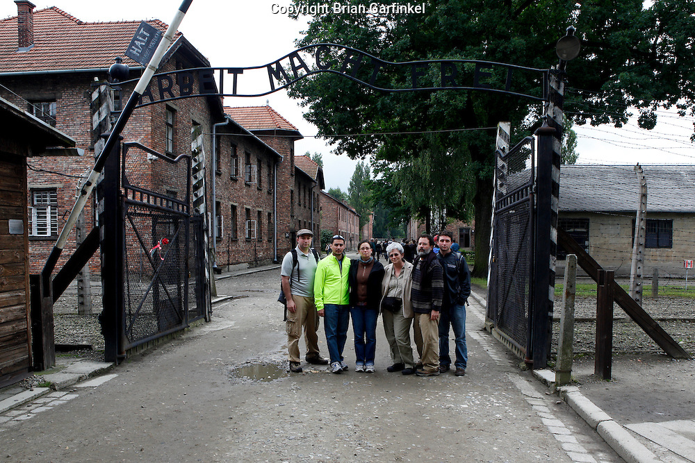 """Me, Jesus, Kate, Mom, Dad, and Joel pose for a picture in front of the sign above the entrance to Auschwitz that reads """"Work sets you free"""" in Auschwitz Concentration Camp in Poland on Tuesday July 5th 2011.  (Photo by Brian Garfinkel)"""