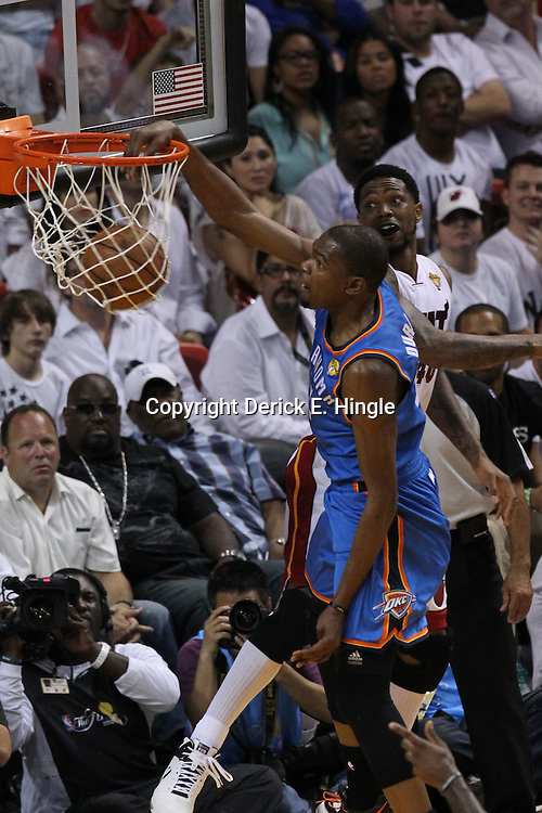 Jun 21, 2012; Miami, FL, USA; Oklahoma City Thunder small forward Kevin Durant (35) dunks against Miami Heat power forward Udonis Haslem (40) during the first quarter in game five in the 2012 NBA Finals at the American Airlines Arena. Mandatory Credit: Derick E. Hingle-US PRESSWIRE