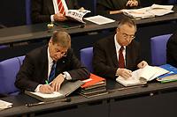 """19 DEC 2002, BERLIN/GERMANY:<br /> Wolfgang Clement (Mi-L), SPD, Bundeswirtschaftsminister, und Hans Eichel (Mi-R), SPD, Bundesfinanzminister, schreiben in Unterlagen, waehrend der Debatte zur Regierungserklaerung des BK """"Ergebnisses des Europaeischen Rates"""", Plenum, Deutscher Bundestag<br /> IMAGE: 20021219-01-035<br /> KEYWORDS: Sitzung, schreibt, Akte, papers"""