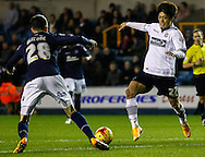Scott Malone of Millwall and Lee Chung-Yong of Bolton Wanderers battle for the ball during the Sky Bet Championship match at The Den, London<br /> Picture by David Horn/Focus Images Ltd +44 7545 970036<br /> 19/12/2014