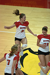 12 October 2006: Kelly Waterstraat (3), Peggy Riessen (25), Kelly Mollerus (behind 7), and Mary Catherine Richmond (7) celebrate a point. The Redbirds of Illinois State beat the Braves of Bradley 3 games to 1 in a best of 5 match. The match took place at Redbird Arena on the campus of Illinois State University in Normal Illinois.<br />