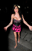 26.OCTOBER.2009. LONDON<br /> <br /> POP DIVA AMY WINEHOUSE LEAVING THE GAUCHO GRILL, MAYFAIR AT 8.15PM WEARING A BLACK CORSET WITH HER NIPPLE HANGING OUT AND A PINK MINI SKIRT, AFTER EARLIER ATTENDING THE Q MUSIC AWARDS AT THE GROVSENOR HOTEL<br /> <br /> BYLINE: EDBIMAGEARCHIVE.COM<br /> <br /> *THIS IMAGE IS STRICTLY FOR UK NEWSPAPERS AND MAGAZINES ONLY*<br /> *FOR WORLD WIDE SALES AND WEB USE PLEASE CONTACT EDBIMAGEARCHIVE - 0208 954 5968*