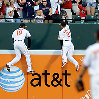 29 June 2009:  Baltimore Orioles center fielder Adam Jones (10) and right fielder Nick Markakis (21) both leap at the wall for a 2-run home run by Boston Red Sox right fielder J.D. Drew that scored catcher Jason Varitek in the 4th inning at Camden Yards in Baltimore, MD.  The Red Sox defeated the Orioles 4-0.  ****For Editorial Use Only****