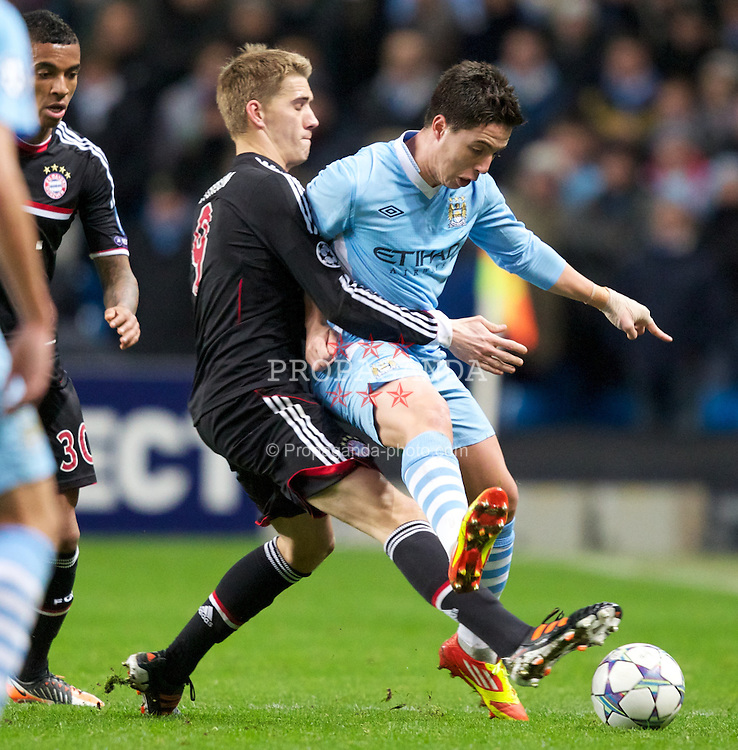 MANCHESTER, ENGLAND - Wednesday, December 7, 2011: Manchester City's Samir Nasri in action against FC Bayern Munchen's Nils Petersen during the UEFA Champions League Group A match at the City of Manchester Stadium. (Pic by Vegard Grott/Propaganda)