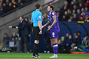 Shrewsbury Town midfielder Oliver Norburn (8) pleads innocence to the referee during the EFL Sky Bet League 1 match between Oxford United and Shrewsbury Town at the Kassam Stadium, Oxford, England on 7 December 2019.