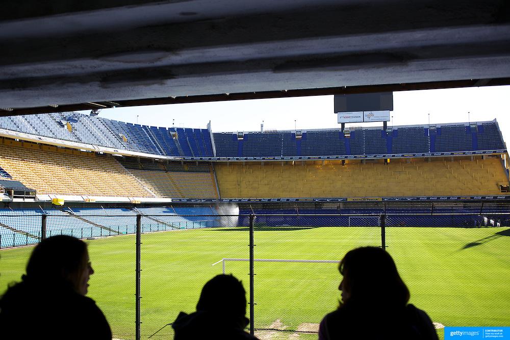 A tour group surveys the famous Boca Juniors football stadium, La Bombonera, in La Boca region of Buenos Aires, Argentina, 25th June 2010. Photo Tim Clayton..