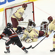 Thatcher Demko #30 of the Boston College Eagles watches a flying puck, shot by Ryan Belonger #16 of the Northeastern Huskies during The Beanpot Championship Game at TD Garden on February 10, 2014 in Boston, Massachusetts. (Photo by Elan Kawesch)