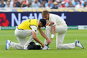 Stuart Broad of England has his boots adjusted during the International Test Match 2019 match between England and Australia at Edgbaston, Birmingham, United Kingdom on 3 August 2019.