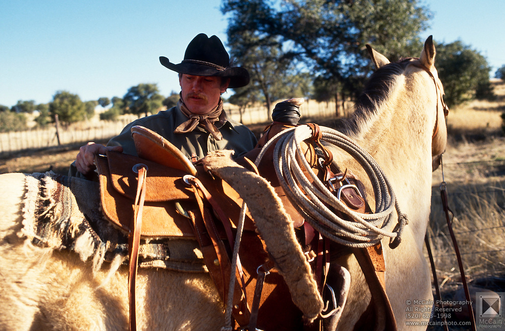Mark Duncan uses a saddle made by Dave and Roy Salge, Vera Earl Ranch, Sonoita, Arizona.©1991 Edward McCain. All rights reserved. McCain Photography, McCain Creative, Inc.