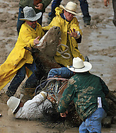 Bareback Rider JACOB HENRY GARON gets trapped riding 68 NICKELS JK and gets a reride, 28 July 2007, Cheyenne Frontier Days