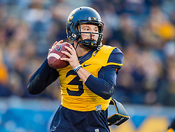 Oct 10, 2015; Morgantown, WV, USA; West Virginia Mountaineers quarterback Skyler Howard warms up before the game against the Oklahoma State Cowboys at Milan Puskar Stadium. Mandatory Credit: Ben Queen-USA TODAY Sports