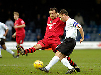 Photo: Leigh Quinnell.<br /> Luton Town v Cardiff City. Coca Cola Championship. 01/01/2007. Cardiffs Riccardo Scimeca challenges Lutons Sol Davis.