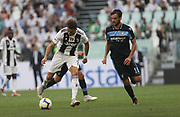 Cristiano Ronaldo (Juventus Turin)and Marco Parolo (Lazio Rome) during the Italian championship Serie A match between Juventus Turin and Lazio Roma at Allianz Stadium in Turin, Italy, on August 25, 2018 - Picture by Laurent Lairys / ProSportsImages / DPPI
