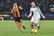 Hull City midfielder Jake Livermore (14) and Jonjo Shelvey (12) Newcastle United midfielder  during the EFL Quarter Final Cup match between Hull City and Newcastle United at the KCOM Stadium, Kingston upon Hull, England on 29 November 2016. Photo by Ian Lyall.