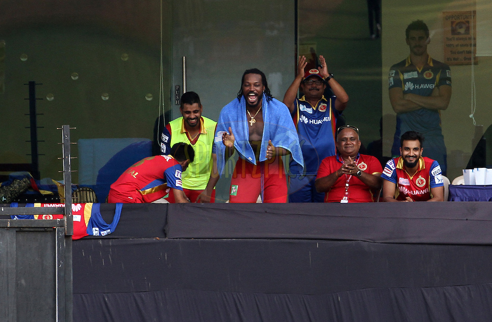 Royal Challengers Bangalore player Chris Gayle cheers from the dressing room during match 46 of the Pepsi IPL 2015 (Indian Premier League) between The Mumbai Indians and The Royal Challengers Bangalore held at the Wankhede Stadium in Mumbai, India on the 10th May 2015.<br /> <br /> Photo by:  Vipin Pawar / SPORTZPICS / IPL