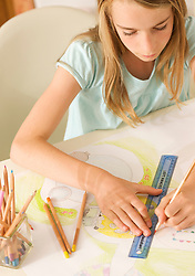 Young girl drawing with a left handed ruler