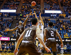 Dec 30, 2018; Morgantown, WV, USA; West Virginia Mountaineers guard Jordan McCabe (5) shoots a three pointer during the second half against the Lehigh Mountain Hawks at WVU Coliseum. Mandatory Credit: Ben Queen-USA TODAY Sports