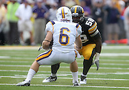 September 3, 2011: Iowa Hawkeyes defensive lineman Lebron Daniel (58) eyes Tennessee Tech Golden Eagles running back Adam Urbano (6) during the first half of the game between the Tennessee Tech Golden Eagles and the Iowa Hawkeyes at Kinnick Stadium in Iowa City, Iowa on Saturday, September 3, 2011. Iowa defeated Tennessee Tech 34-7 in a game stopped at one point due to lightning and rain.