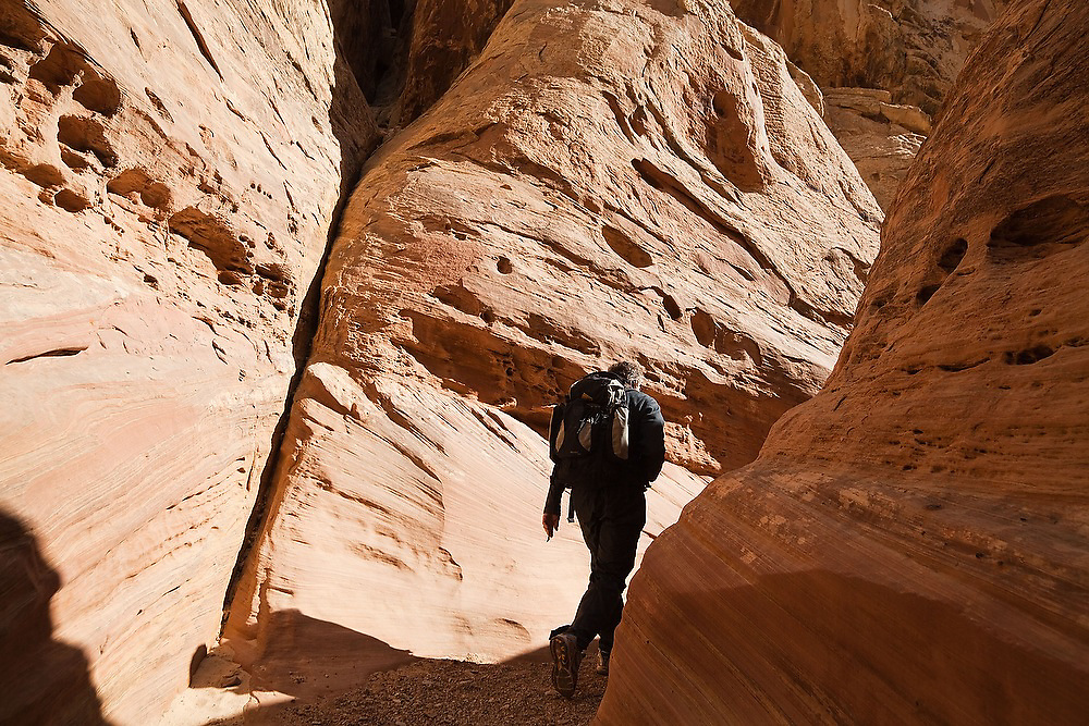 University of Colorado geomorphology professor Robert Anderson hikes up narrow Little Wild Horse Canyon, San Rafael Swell, Utah.