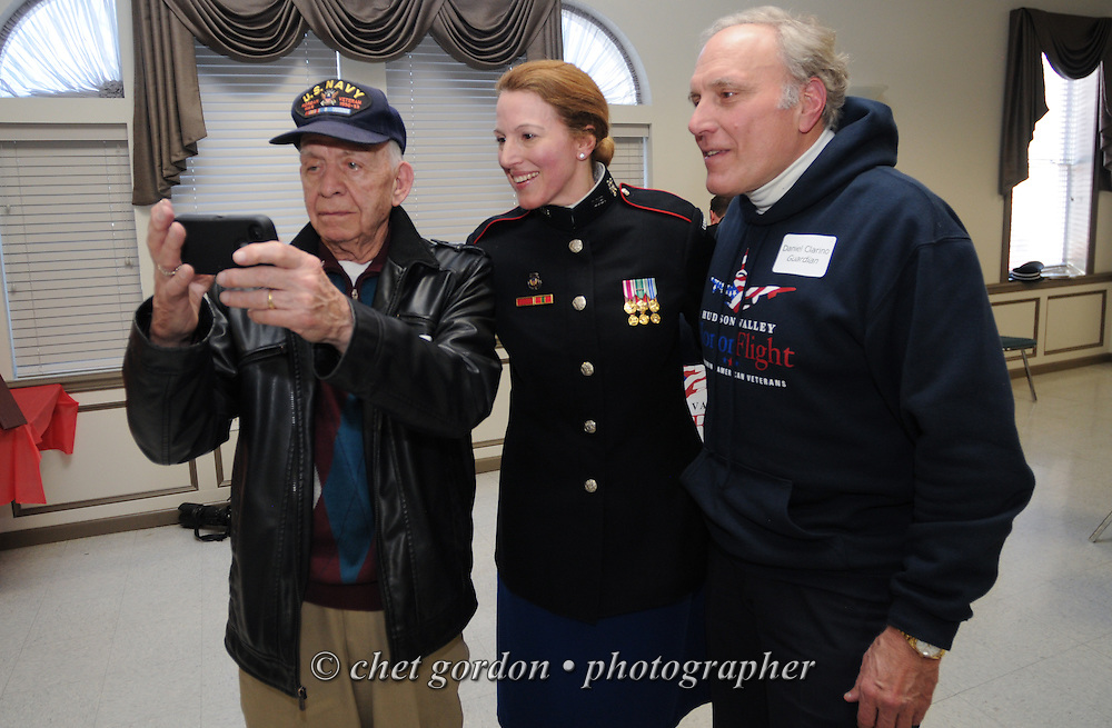 Hudson Valley Honor Flight's Meet and Greet at the Walden Firehouse in Walden, NY on Sunday, March 22, 2015. Nearly one hundred WWII and Korean War Veterans and their escorts will be onboard the Hudson Valley Honor Flight's  7th. flight from Stewart International Airport to Washington, DC on April 11th. Hudson Valley Honor Flight is a chapter of the Honor Flight Network, which provides free flights for WWII and Korean War Veterans and tours of the WWII and Korean War Memorials, Arlington National Cemetery and the Iwo Jima / Marine Corps Memorial in the nation's capital.  © Chet Gordon for Hudson Valley Honor Flight