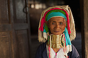 Long Neck Ring Lady at her home in full traditional clothing, loi kai