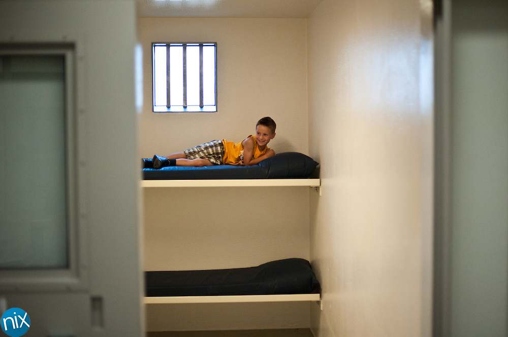 Josh Gadd lays on a bed in a cell during an open house at the new Cabarrus County Detention Center on Friday, June 10. The new jail will open for inmates next week.   (Photo by James Nix)