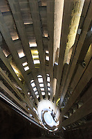 Looking down the centre of the Passion Facade tower in the Sagrada Familia, the Antoni Gaudi designed church in the heart of Barcelona, Spain.