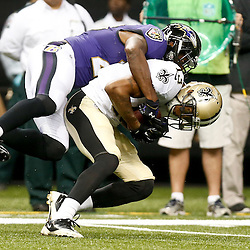 Aug 28, 2014; New Orleans, LA, USA; New Orleans Saints wide receiver Joseph Morgan (13) is tackled by Baltimore Ravens defensive back Brynden Trawick (28) during the first quarter of a preseason game at Mercedes-Benz Superdome. Mandatory Credit: Derick E. Hingle-USA TODAY Sports