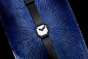 Graphic wristwatch on blue abstract background