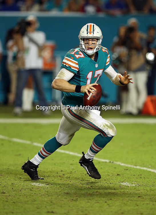 Miami Dolphins quarterback Ryan Tannehill (17) rolls out and throws an incomplete fourth quarter pass during the NFL week 14 regular season football game against the New York Giants on Monday, Dec. 14, 2015 in Miami Gardens, Fla. The Giants won the game 31-24. (©Paul Anthony Spinelli)