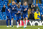 Chelsea defender Cesar Azpilicueta (28), Chelsea midfielder Ngolo Kante (7), Chelsea forward Olivier Giroud (18), warming-up, before the Premier League match between Chelsea and Brighton and Hove Albion at Stamford Bridge, London, England on 3 April 2019.