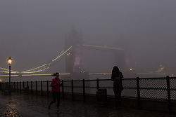 © Licensed to London News Pictures. 30/12/2016. LONDON, UK.  Tower Bridge on the River Thames is shrouded in fog. London is experiencing more freezing and foggy weather this morning.  Photo credit: Vickie Flores/LNP