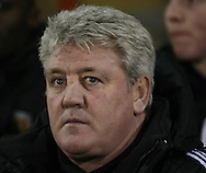 Picture by David Horn/Focus Images Ltd +44 7545 970036.15/01/2013.Steve Bruce Manager of Hull City looks on during the The FA Cup match at the Matchroom Stadium, London.