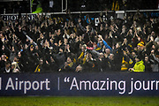 Newport fans celebrate at full time after a 2-0 win over Middlesbrough during the The FA Cup match between Newport County and Middlesbrough at Rodney Parade, Newport, Wales on 5 February 2019.