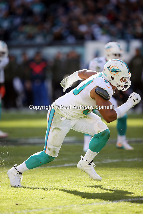 Miami Dolphins defensive end Olivier Vernon (50)) rushes during the 2015 week 10 regular season NFL football game against the Philadelphia Eagles on Sunday, Nov. 15, 2015 in Philadelphia. The Dolphins won the game 20-19. (©Paul Anthony Spinelli)